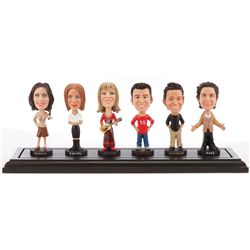 Exclusive cast gift of bobblehead dolls of entire Friends cast