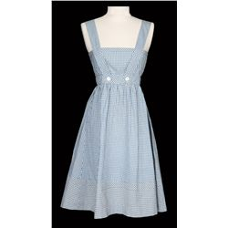 "Judy Garland screen-used ""Dorothy Gale"" blue and white gingham pinafore dress from The Wizard of OZ."