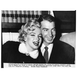 Marilyn Monroe and Joe DiMaggio wire photo from their wedding day