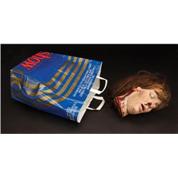 Shopping bag and prosthetic severed head from Stephen King's Cat's Eye
