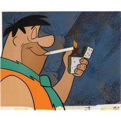 Production cel of Fred Flintstone and background from Winston cigarettes sponsorship titles