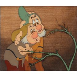 Six original production cels featuring all Seven Dwarfs from Snow White and the Seven Dwarfs, signed