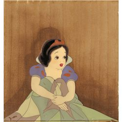 Snow White production cel from Snow White & the Seven Dwarfs on Courvoisier wooden background