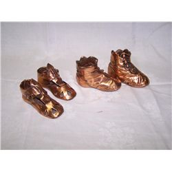 Copper baby shoes and boots.