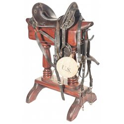 Cavalry Saddle, Saddle Stand, U.S. Marked Bridle, Sword and a Canteen