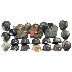 Three Nazi Jackets and a Grouping of Nineteen German Helmets