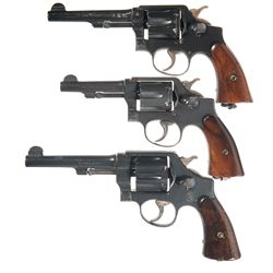 Three Smith & Wesson Double Action Revolvers -A) British Proofed Smith & Wesson Victory Model Double