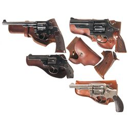 Four Smith & Wesson Double Action Revolvers with Holsters and One Box of Books -A) Smith & Wesson .2