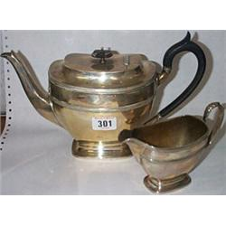 * A Silver Tea Pot and Creamer - Sheffield...