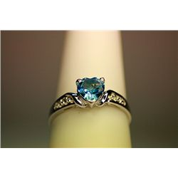 Lady's Fancy White Gold Blue Topaz Diamond Ring