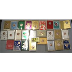 1 LOT OF 24 BOXES OF CHRISTMAS CARDS BY FRANKLIN MINT, EACH CARD HAS A MEDAL TOKEN, MAINLY DESIGNED