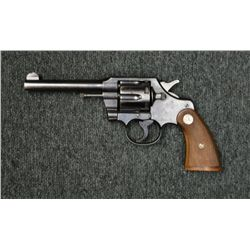 "Colt Official Police DA revolver, .38 cal.,  5"" barrel, blue finish, checkered medallion  wood grips"