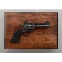 "Presentation wood cased John Wayne ""The Duke""  Commemorative Colt New Frontier SAA  revolver, .22 ca"