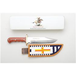 Large Winchester Model 94 Commemorative Bowie  knife with modern beaded leather sheath,  both in ove