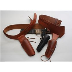 Lot of leather holsters including two  Buscadero-style holsters, each with an  attached cartridge be