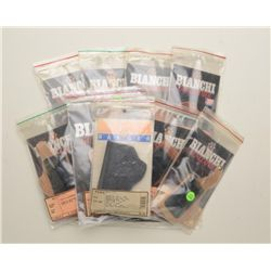 Bonanza lot of 15 Bianchi holsters, like new  in display sleeves including two leather  shoulder hol