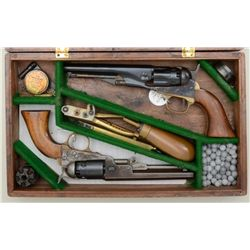 Modern cased pair of reproduction Colt  percussion pocket revolvers including a  repro. copy of a Co