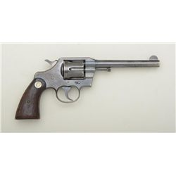 "Colt Official Police DA revolver, .38 cal.,  6"" barrel, blue finish, checkered medallion  wood grips"