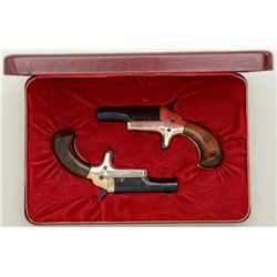 "Pair of modern Colt spur trigger single shot  derringers, .22 short cal., 2-1/2"" barrels,  black and"