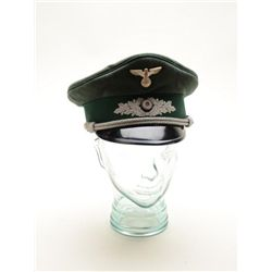 German WW II era visor cap in overall very  good condition; green material silver  braiding, silver