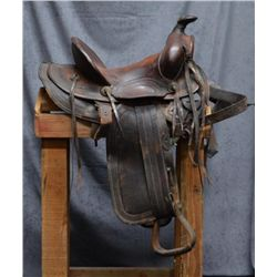 Unmarked tooled leather high back Western  saddle in overall fair + to good condition;  in need of c