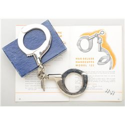 Collectible pair of H&R Model 123 Super  Handcuffs in their original factory two piece  blue cardboa