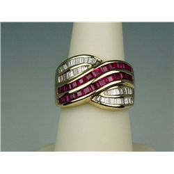 Marvelous 18 karat yellow gold ladies  designer style ring channel set with 24  square cut red rubie
