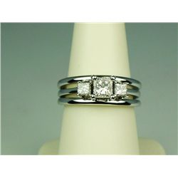 Gorgeous 14 karat white gold ladies three  stone ring set with a center Princess cut  diamond weighi