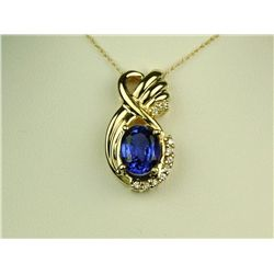 High quality 14 karat yellow gold ladies  custom design necklace set with a center oval  fine color