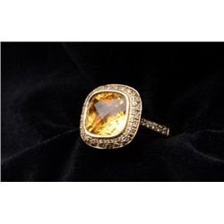One 14k ladies ring in 14k yellow gold set  with a 4.95ct checkerboard cut citrine and  0.45ct of di