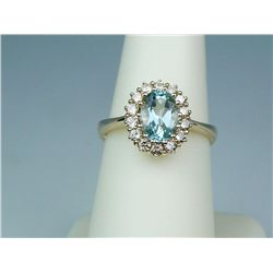 Splendid 14 karat yellow gold ladies ring set  with a center oval blue Aquamarine weighing  approx.