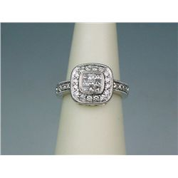 Brilliant 14 karat white gold ladies ring  fine set with round and princess cut diamonds  weighing a