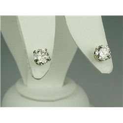 Brilliant 14 karat yellow gold ladies  solitaire earrings set with two round  brilliant cut diamonds
