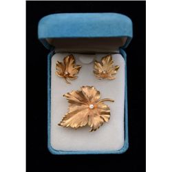 One unique ladies leaf design brooch pin and  matching earrings with diamond accents.   Diamond 0.20