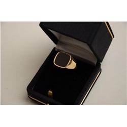 One 14K yellow gold gents ring set with a  black onyx.  Est.:  $175-$350