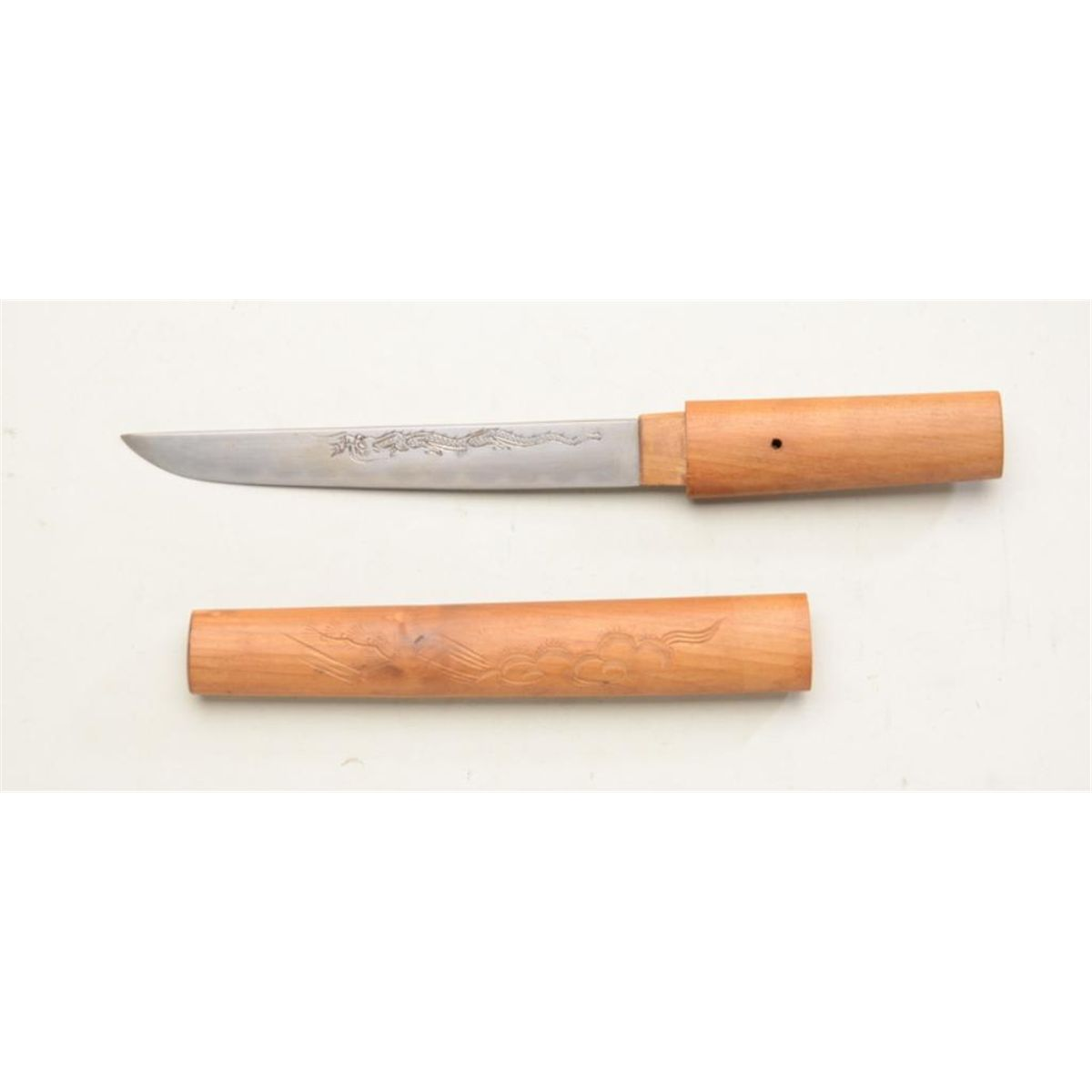 Japanese knife blade in traditional wood storage case ...