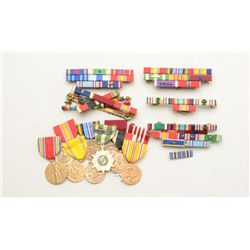 Lot of US military medals and commendation  ribbons from an old estate, ranging from WW  II to Vietn