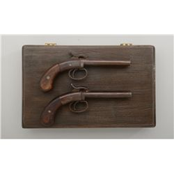 "Modern cased pair of reproduction double  barrel percussion derringers by Hoppe's, .36  cal.,4"" barr"