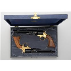 Cased pair of Colt Civil War Centennial Model  diminutive single shot pistols in the style  of the c