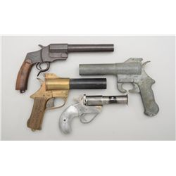 Lot of four old flare pistols including an  old iron piece with wood grip and lanyard  ring in good