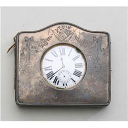 Traveling clock or oversized pocket watch in  traveling case with leather and engraved  silver front