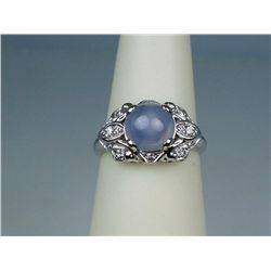 Gorgeous ladies Platinum estate ring set with  a round cabochon star sapphire weighing  approx. 2.00