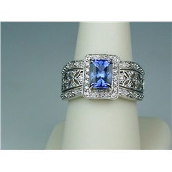 Exquisite 14 karat white gold ladies vintage  design ring set with a center Radiant cut  fine blue T