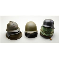 Lot of eight military metal helmets including  a US helmet and liner with camo cover,  possibly Kore