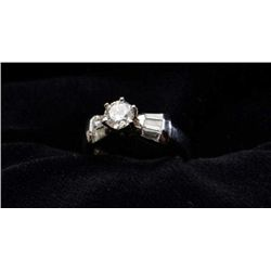 One classic ladies ring made in platinum set  with a fine round brilliant diamond weighing  0.50ct a