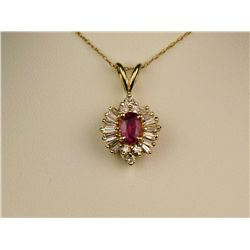 Exquisite 14 karat yellow gold ladies  ballerina design necklace set with a center  oval ruby weighi