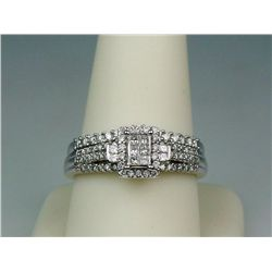 Dazzling 10 karat white gold ladies ring fine  set with over 70 round and princess cut  diamonds wei