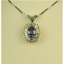 Spectacular 14 karat white gold ladies  ballerina design necklace set with a center  oval Tanzanite