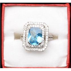 One 14k white gold ring set with a Swiss blue  topaz weighing 3.87ct and 2.18ct of round  diamonds.