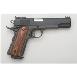 "Rock Island Armory Match Grade semi-auto  pistol, .45 cal., 5"" barrel, mat black  finish, cut out ha"